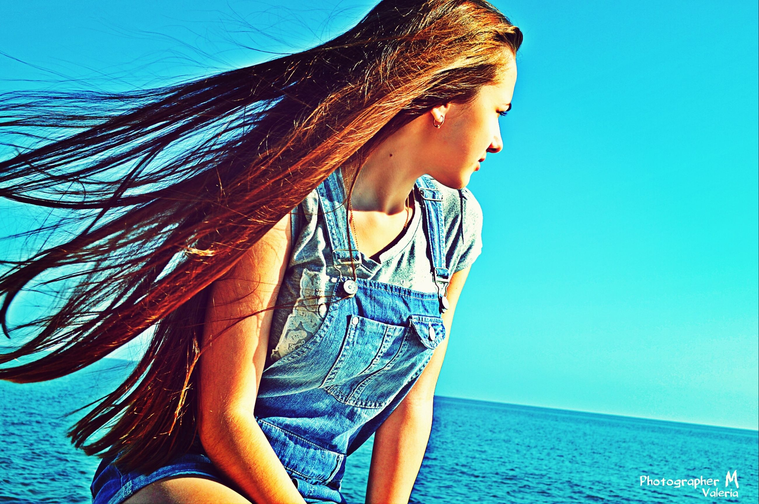 young adult, young women, long hair, blue, lifestyles, water, leisure activity, person, standing, three quarter length, sea, clear sky, casual clothing, bikini, sensuality, brown hair