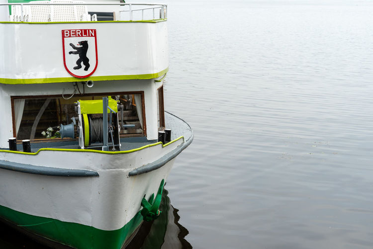 High angle view of text on boat moored at lake