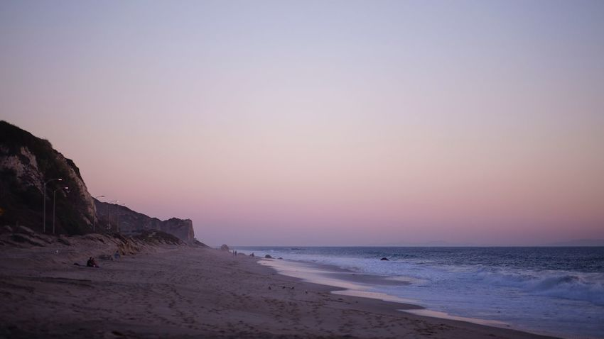 sunset at malibu beach Pacific Pacific Ocean West Coast Rock Formation Cliffs Cliff California Cali Malibu Beach Malibu Purple Sky Sea Beach Sunset Scenics Tranquil Scene Beauty In Nature Sand Nature Sky Horizon Over Water Tranquility Water No People Day Outdoors Clear Sky