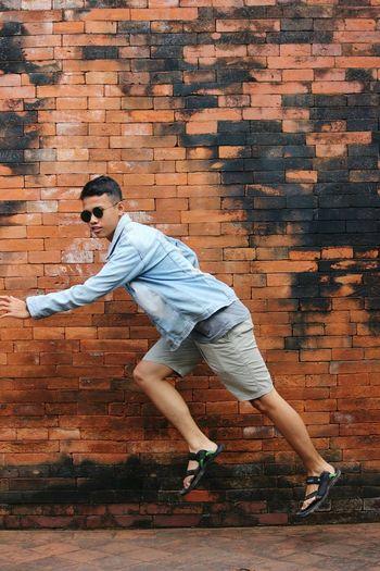 Wall Outdoors People Yogyakarta EyeEm Selects Glasses ASIA INDONESIA Wall Orange Color Fly Jump Running The Fashion Photographer - 2018 EyeEm Awards