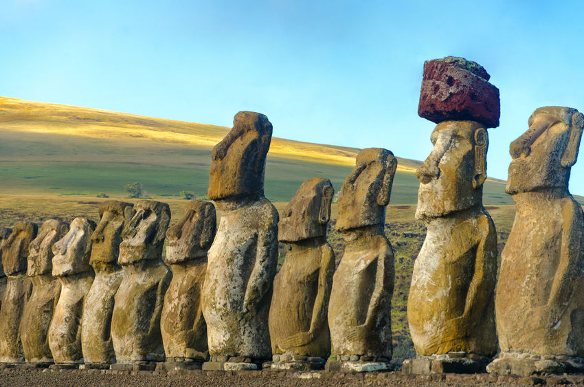 Closeup of a row of Moai at Ahu Tongariki on Easter Island in Chile Ahu Tongariki America Ancient Chile Culture Easter Heritage Indigenous  Island Landscape Moai National Panoramic Park Polynesia Pukao Rapa Nui Sculture South Statue Stone Tourism Travel UNESCO World Heritage Site World