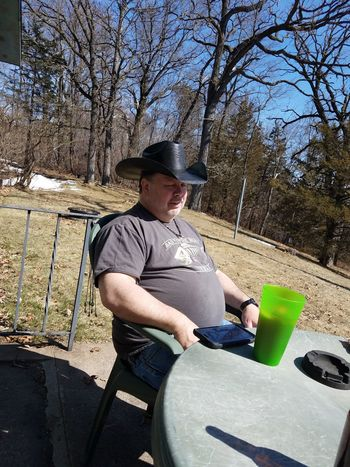 Another of my husband. One Person Real People Sitting Leisure Activity Sunlight Casual Clothing Day Nature Hat Men