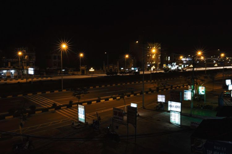 View of illuminated street light at night