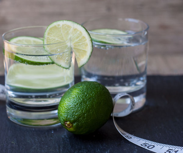 Lemon slices in water by tape measure
