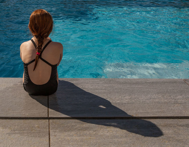 Summer Exploratorium Backgrounds Blue Hairstyle Leisure Activity Lifestyles Light And Shadow One Person Outdoors Pool Relaxation Shadow Sitting Sunlight Swimming Pool Turquoise Colored Water Going Remote This Is Natural Beauty International Women's Day 2019