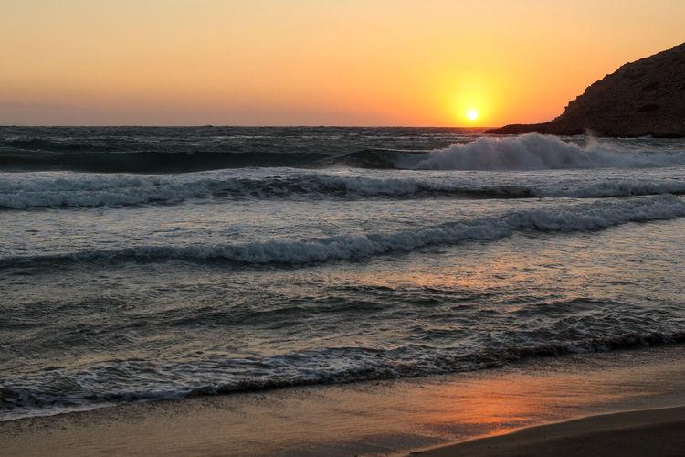 Sunset Water Sea Sky Motion Wave Beauty In Nature Scenics - Nature Beach Horizon Over Water Land Horizon Orange Color No People Nature Aquatic Sport Idyllic Outdoors Reflection