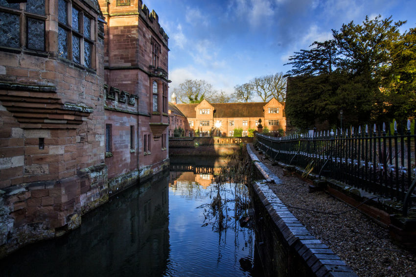 Water Reflections Architecture Building Exterior Built Structure Day History Moat Moats Nature No People Old Buildings Outdoors Reflections In The Water Sky Sun Flare Travel Destinations Tree vanishing point Water