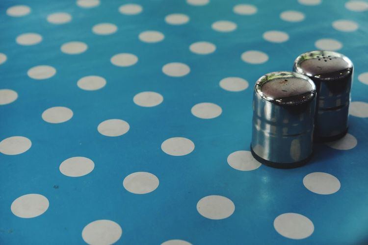 EyeEm Selects Indoors  No People Table Close-up Still Life Pattern Blue Salt - Seasoning Tablecloth Pepper Shaker Focus On Foreground High Angle View Seasoning Geometric Shape Container Two Objects Circle Spotted