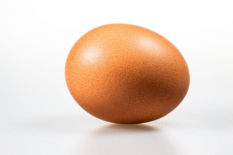 An egg isolated. Animal Egg Brown Close-up Day Easter Easter Egg Egg Egg Carton Egg Yolk Eggcup Eggshell Food Food And Drink Fragility Freshness Healthy Eating Indoors  Isolated White Background No People Protein Single Object Studio Shot White Background