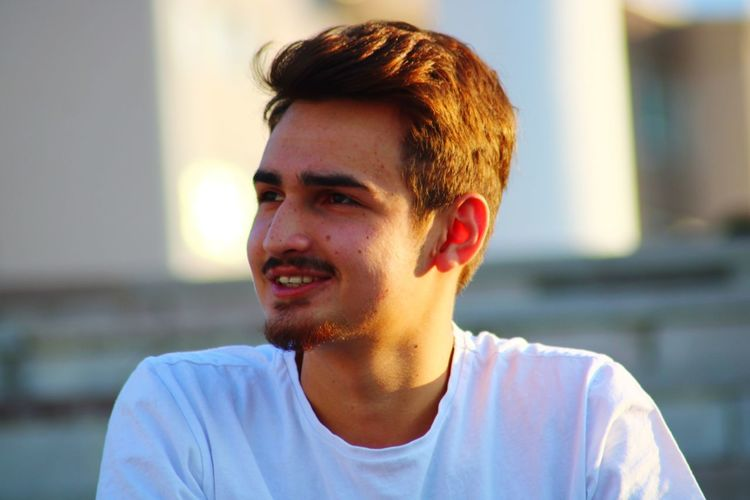 Close-up of smiling young man outdoor
