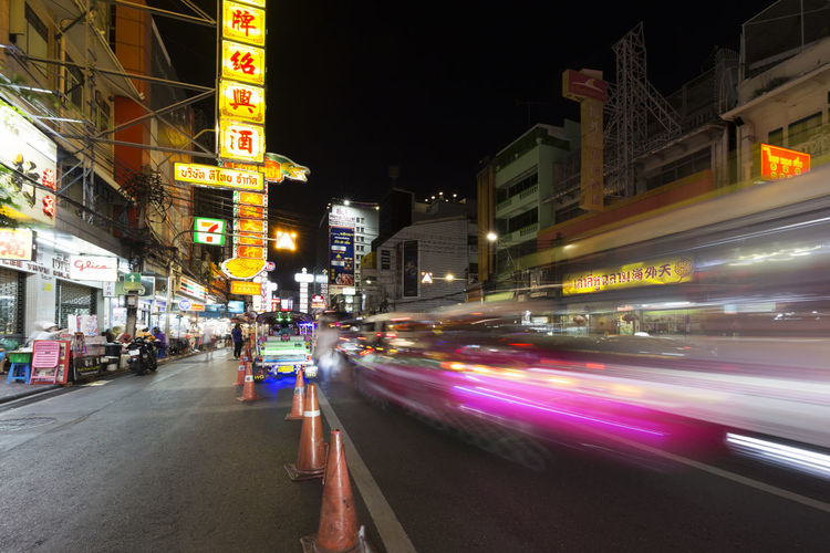 Chinatown Bangkok Illuminated Night Architecture Building Exterior Motion City Blurred Motion Built Structure Speed Transportation City Life Street Road Mode Of Transportation Building City Street Light Trail Car Incidental People Skyscraper Nightlife Bangkok Chinatown Thailand Asien