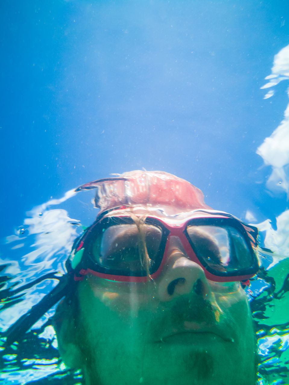 underwater, sea, water, swimming, eyewear, portrait, swimming goggles, leisure activity, nature, real people, headshot, sport, one person, front view, swimwear, blue, men, lifestyles, undersea, swimming pool, outdoors, snorkeling