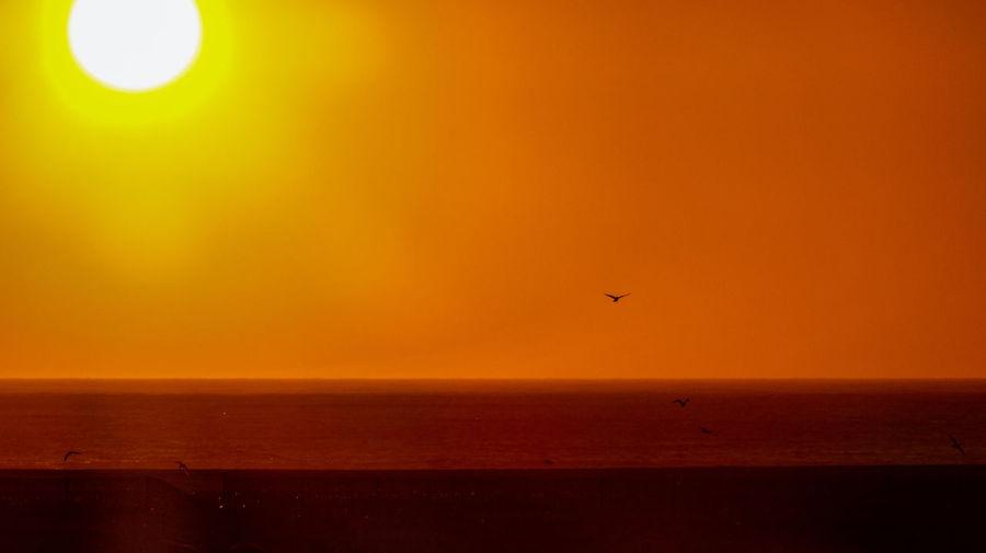 Scenic view of orange sunset sky