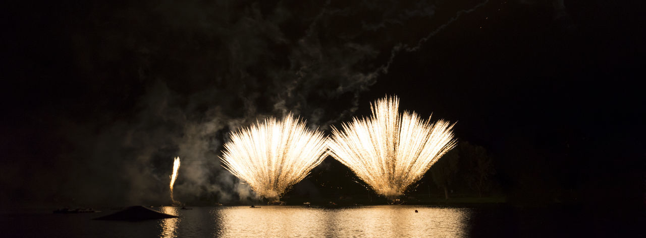Firework Display Over Lake At Olympiapark During Night