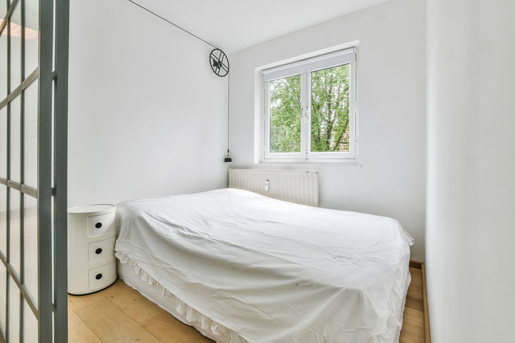 White bed on window at home