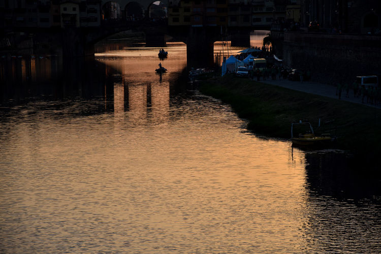 43 Golden Moments Architecture Arno  Arno River Boat Bridge Built Structure Canal City Life Fiume Arno Florence Italy Illuminated Nature Old Bridge Reflection Reflection_collection Reflections And Shadows Reflections In The Water River Sky Sunrise Sunset Tramonto Tranquility Water
