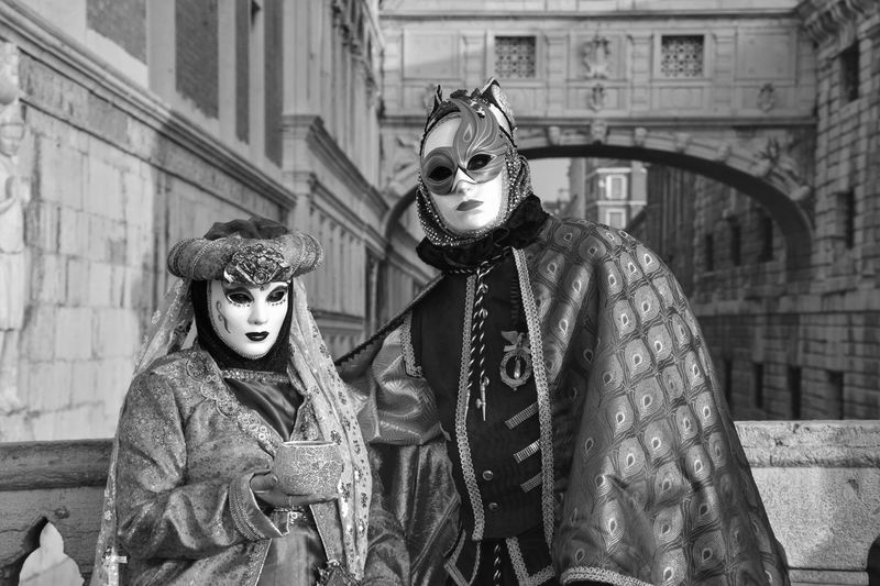 Two People Building Exterior Cultures Outdoors Mask - Disguise People Togetherness Venetian Mask Adults Only Day Adult Arts Culture And Entertainment Period Costume 2017 Carnival Mask Venice Italy Blackandwhite Streetphotography Lifestyles Carnival Crowds And Details Fashion Stage Costume Stage Make-up