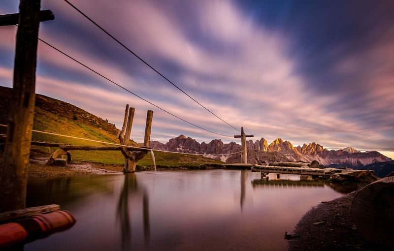 Alta tensione Water Sky Cloud - Sky Reflection Nature Architecture Built Structure Mountain Sunset Cable Beauty In Nature Connection No People Building Exterior Electricity  Scenics - Nature Outdoors