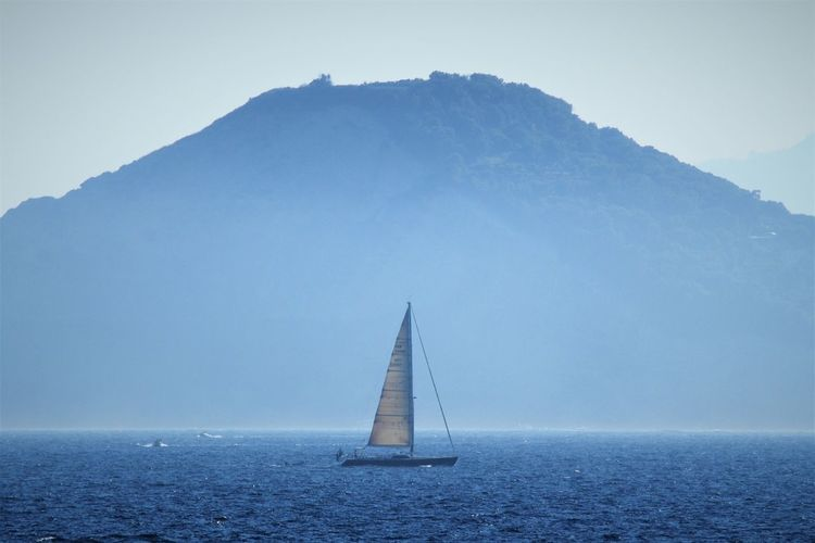 Osmosi Sailboat Water Nautical Vessel Sea Sailing Transportation Mode Of Transportation Horizon Over Water Horizon Tranquility Tranquil Scene Mountain Nature Sky Sailing Ship Travel No People Scenics - Nature Outdoors Beauty In Nature