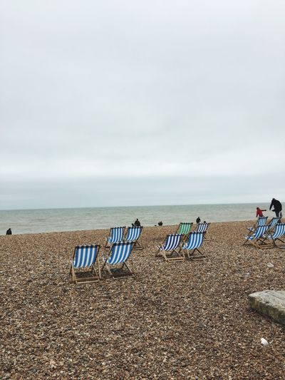 Beach days are priceless being sun or rain Happy No Worries Fresh Air... Relaxing Chaiselounge Pebble Beach Pebble Brighton Beach Brighton Beach Photography Beach Sea Water Beach Sky Land Beauty In Nature Nature Horizon Tranquility Day Scenics - Nature Chair Outdoors Horizon Over Water Idyllic Sand Side By Side No People Tranquil Scene