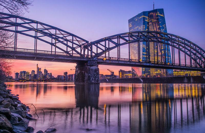 Reflection of bridge in city