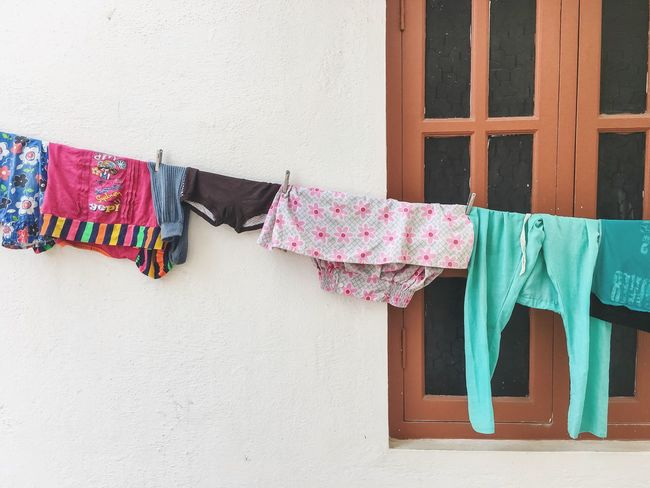 Hanging Built Structure Clothing Architecture Clothesline Building Exterior No People Day Drying Window Multi Colored Outdoors Minimalism Minimal Windows Save Electricity Save Energy drying naturally Laundry Laundry Day The Graphic City Visual Creativity