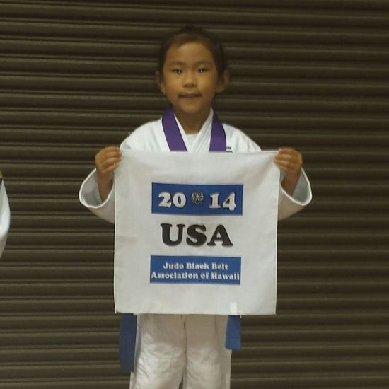 My younger goddaughter won first place