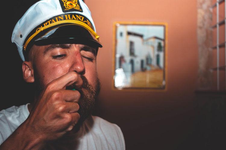 Portrait of a man wearing captains hat