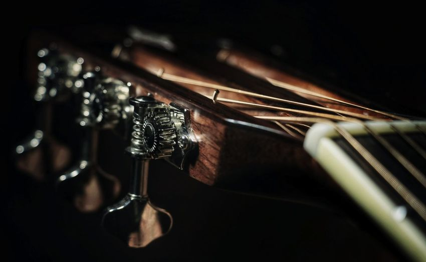 Close-Up Of Musical Instrument Against Black Background