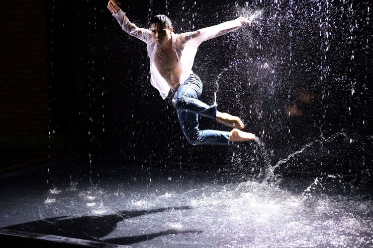 The Male Break Dancer in water on dark background Market Details Dancer Water Images Stock Photo Photography Dancer Water Multi Exposure One Person Full Length Motion Real People Nature Splashing Men Vitality Skill  Indoors  Sea Young Adult Performance Jumping Shirtless Mid-air Strength Swimming Pool Human Arm Capture Tomorrow