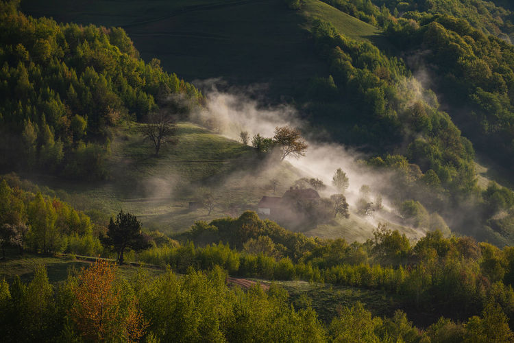Morning rural scene of a mountain village in the spring season.