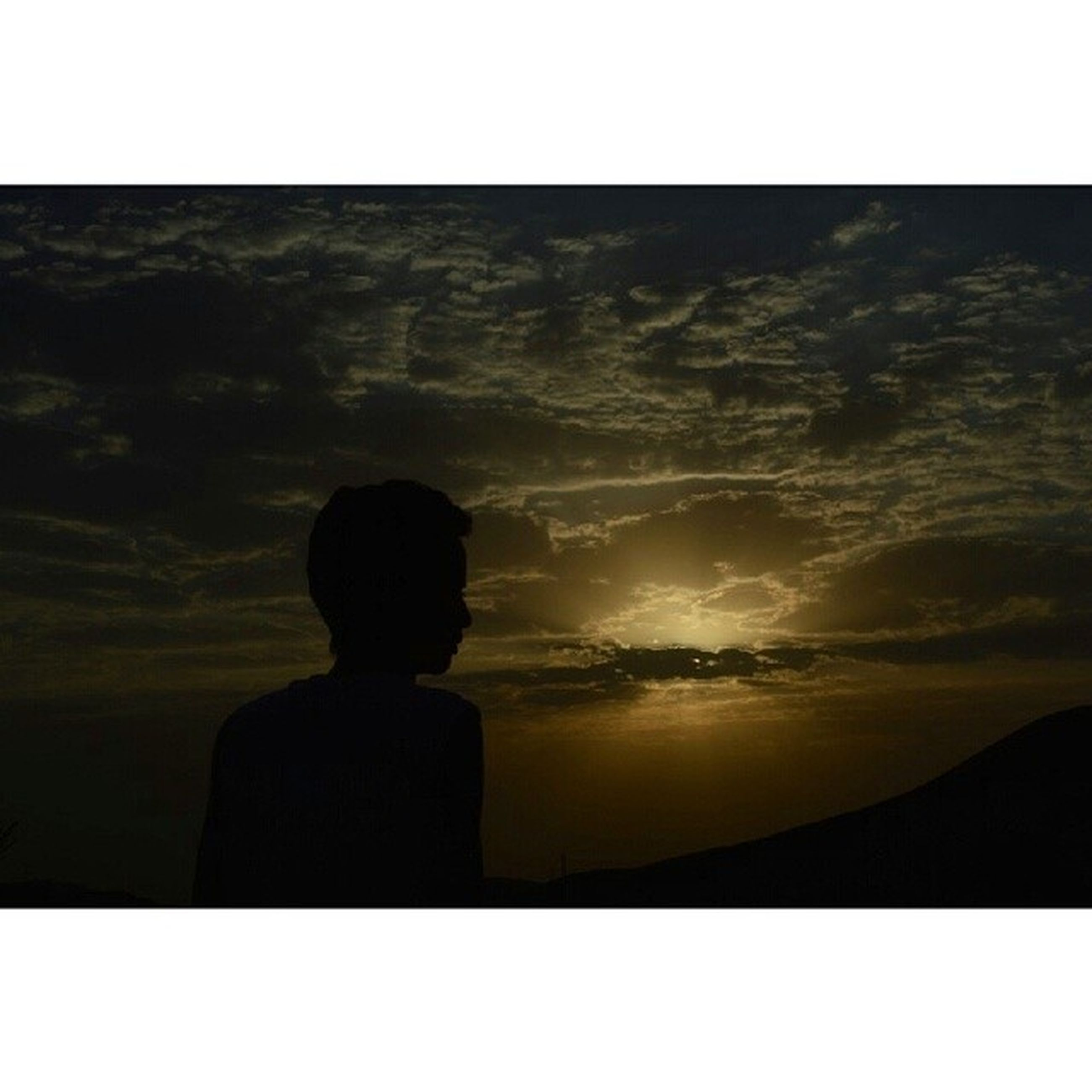 transfer print, silhouette, sunset, auto post production filter, sky, tranquil scene, scenics, tranquility, beauty in nature, standing, nature, idyllic, men, rock - object, outline, rear view, sun, copy space