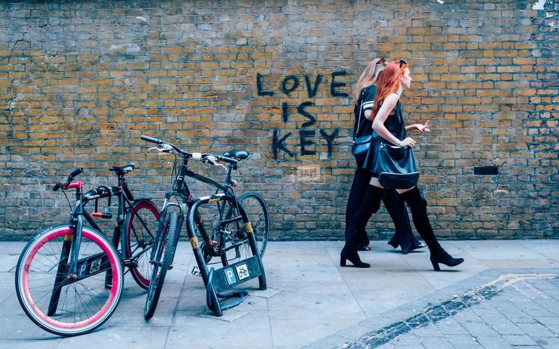 Love is key Bicycle Young Adult People Photography Life On The Streets Color Photography Streetphotography Red Hair Uban Life Bricklanebikes Bricklane Road Brick Wall Garfiti L Red Hair