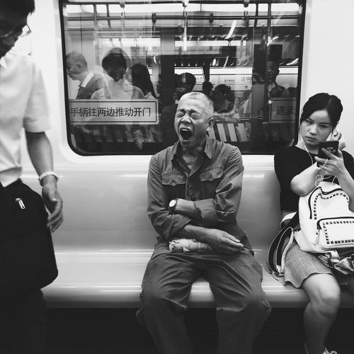 Shanghai B&w Monochrome Streetphotography Real People Lifestyles Rail Transportation Transportation Three Quarter Length Mode Of Transportation Leisure Activity Train - Vehicle Public Transportation Train Group Of People Sitting People Women Casual Clothing Land Vehicle Indoors  Vehicle Interior Front View Men