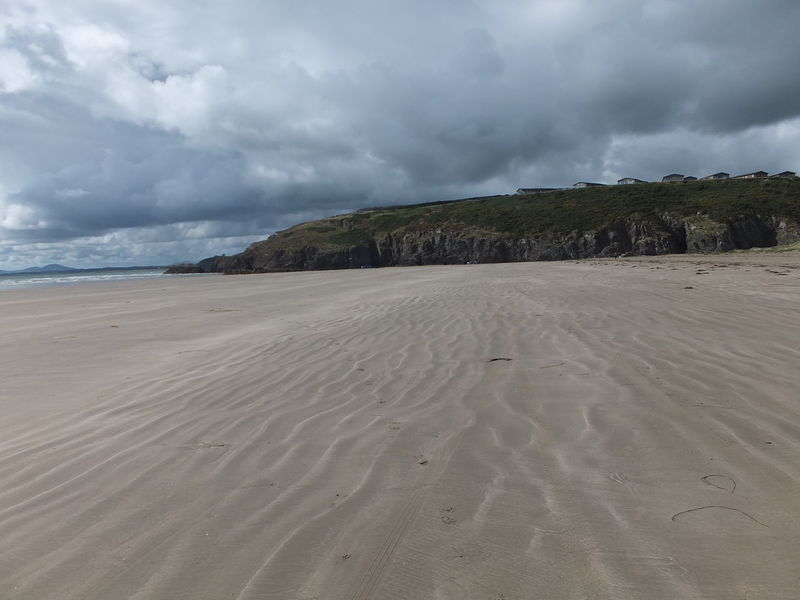 Black Rock Beach, North Wales Beach Beauty In Nature Black Cloudy Sky Black Rock Beach Cloudy Composition Day GB Idyllic Landscape Nature No People Non-urban Scene North Wales Remote Remote Place Sand Scenics Sea Shore Tranquil Scene Tranquility Uk Water