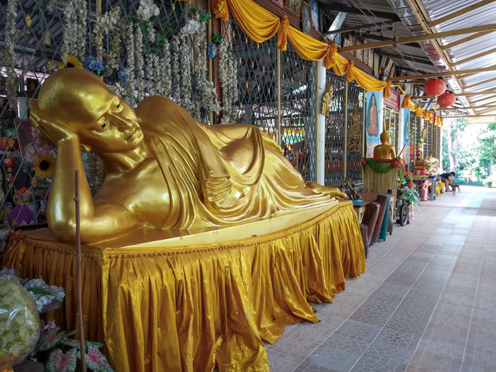 "buddhism temple in Thailand call ""WAT-THAM-THUM-MAT"" Buddhism Mahayana Religious  Cult Contentment Donate Matta Give Benefaction Image Of Buddha Buddha Image Buddha Statue Buddhist Temple Yellow Robe Yellow Reclining Buddha Thailand Temple Thai Temple Country Old-fashioned Antiquity Religion Carousel Arts Culture And Entertainment Amusement Park Ride Amusement Park Religion Gold Colored Gold"