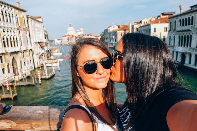 young women cheek kiss in venice Italy Venice Venice, Italy Italy Travel Travel Destinations Architecture Sunglasses Real People Women Water City Portrait Leisure Activity Lifestyles Headshot Two People Glasses Adult Day Togetherness Young Adult Outdoors Hairstyle Kiss Couple