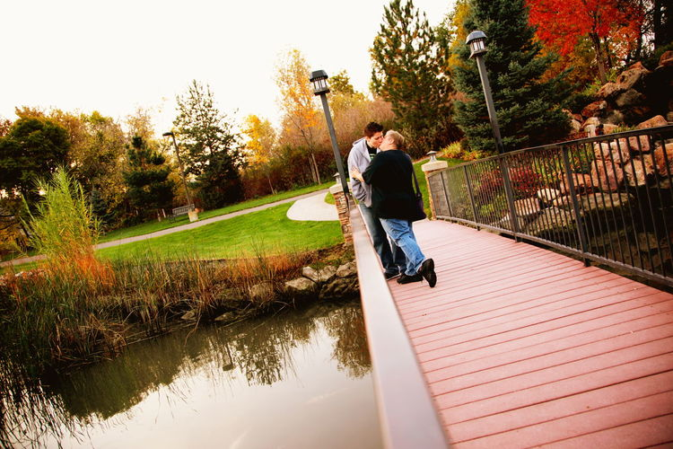 Lgbt Family Lesbian Couple Queer Women Autumn Bridge Couple Creek Full Length Gay Kiss Landscape Lesbian Lgbt Love Nature Nature Walk Outdoors Person Pond River Standing Stream Tree Water Women Young Adult Young Women Two People Togetherness