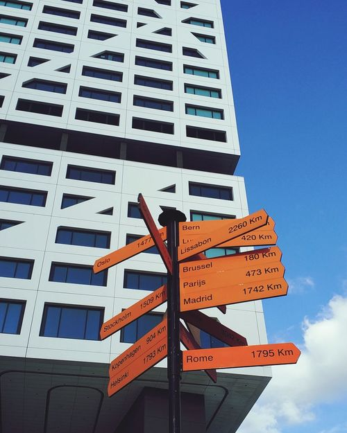 Where are you EyeEm Selects Communication Guidance Low Angle View Direction Outdoors Architecture Buildingstyles Buildings Architecture Utrecht , Netherlands Day Road Sign No People Sky Utrecht Centraal The Graphic City