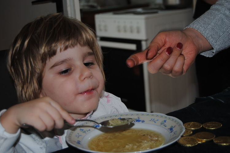 Boy Eating Noodle Soup While Sitting At Home