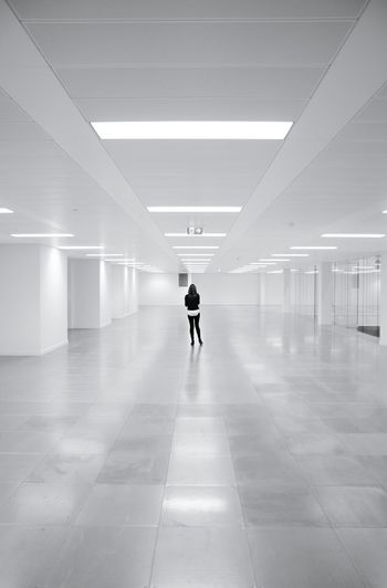 TakeoverContrast Minimalism Minimal Minimalobsession Minimalist Diminishing Perspective Full Length Rear View Illuminated Modern Ceiling Indoors  Architecture Black And White Empty People And Places Monochrome Photography