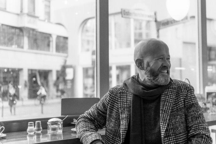 Portrait of man sitting in restaurant