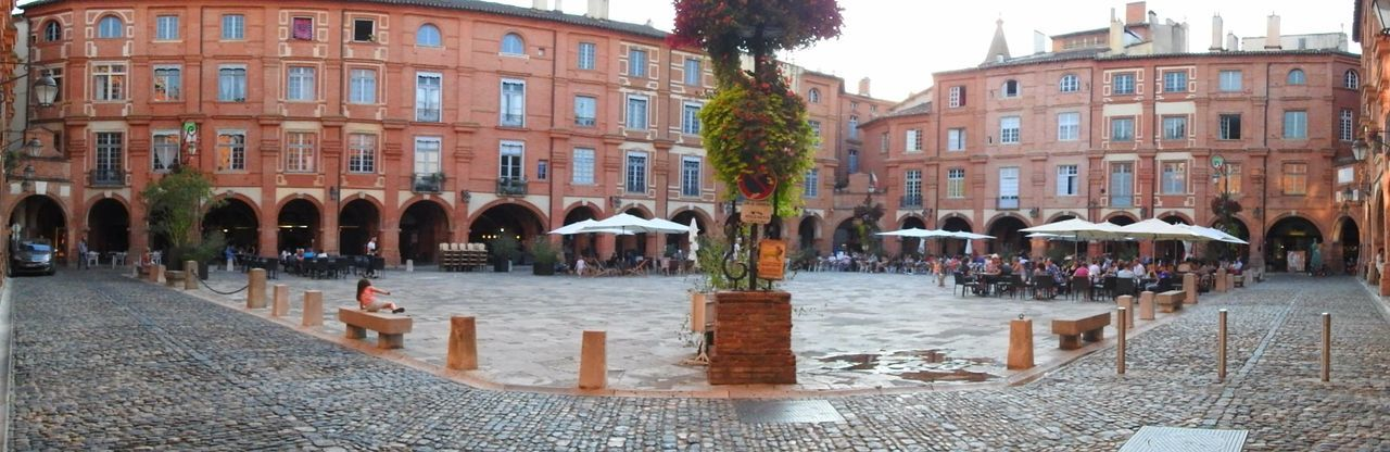 Montauban France Place Nationale Montauban Battle Of The Cities Architecture Building Exterior Built Structure City Large Group Of People Street Arch City Life Transportation Tree City Street Water Travel Destinations Day In Front Of Sky Outdoors Old Town Waterfront