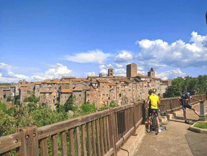 Cyclist Enjoying The View Italian Town Old Town Panorama Trip Vacations Bicycle Bike Cloud - Sky Discover Italy Eco Tourism Italy Leisure Activity Lifestyles Nature Outdoors Riding Sky Sunlight Tourism Transportation Trip Photo Tuscia  Yellow #FREIHEITBERLIN