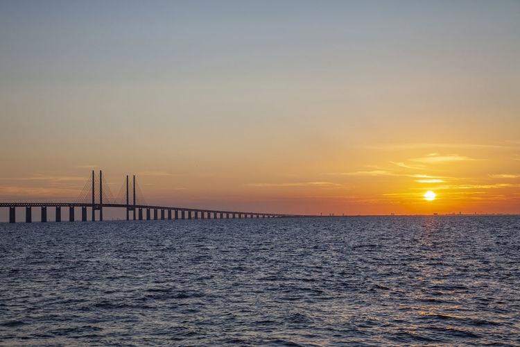 Öresund bridge at the evening with sunset Water Sky Sea Sunset Idyllic Outdoors öresund øresund Bridge Sweden Denmark Malmö