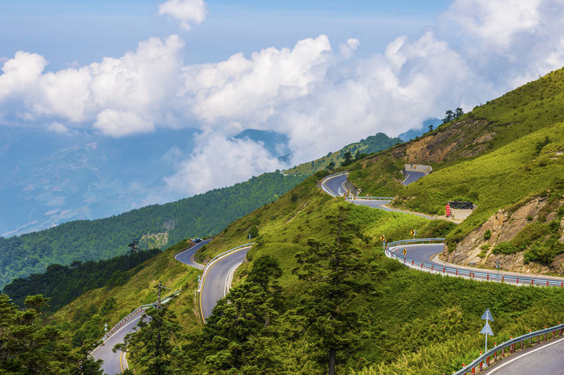 Beauty In Nature Cloud - Sky Curve Day High Angle View Landscape Mountain Mountain Range Mountain Road Nature No People Outdoors Road Scenics Sky Tranquility Transportation Tree Water Winding Road