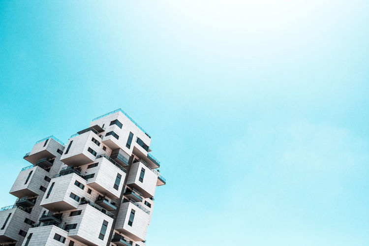 Architecture Built Structure Sky Building Exterior Building Blue Copy Space Low Angle View Residential District Clear Sky No People Nature Day House Outdoors City Apartment Sunlight Tower Tree Luxury Housing Development