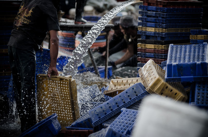 Fisherman Washing Baskets