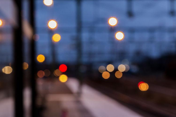 Defocused lights on road at night