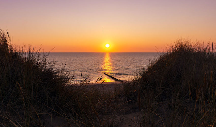 Sunset at Kampen Beach Kampen, Sylt Sylt, Germany Beach Beauty In Nature Grass Horizon Over Water Marram Grass Nature No People North Sea Ocean Orange Color Outdoors Romantic Sky Scenics - Nature Sea Sky Sun Sunlight Sunset Sylt Tranquil Scene Tranquility Water